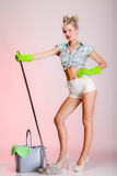 Sexy woman housewife cleaner with mop. Full length sexy girl retro style with mop, woman housewife cleaner in domestic role. Traditional sharing household chores Stock Image