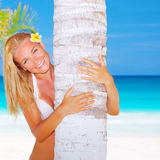 woman hug palm tree Stock Images