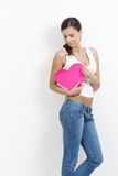 Sexy woman hugging paper heart smiling Stock Image