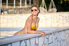 Free Sexy Woman In Bikini On The Sun-tanned Slim And Shapely Body Is Posing Near The Swimming Pool Royalty Free Stock Photos - 170478768