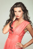 Sexy Woman In Red Dress Holding Her Neck With Hand