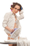 Sexy woman ironing clothes Royalty Free Stock Photography