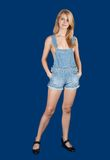 Sexy woman in jeans overall Stock Photo