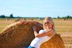 Sexy woman in a jeans shorts on field.  Stock Image