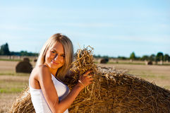 Sexy woman in a jeans shorts on field Royalty Free Stock Photos