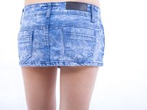 Sexy woman and jeans skirt Royalty Free Stock Photos