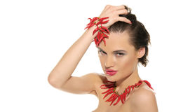 woman with jewelry of red hot pepper Royalty Free Stock Photo