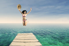 Sexy woman jumping at pier 1 Stock Images