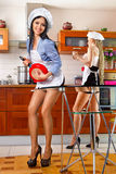 Sexy woman in kitchen Stock Photo