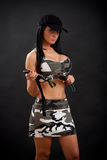 Woman with knife. Busty woman in military outfit with knife stock image