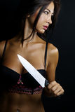 Sexy woman with a knife Royalty Free Stock Photos