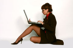 Sexy woman with laptop. Portrait of a sexy woman in glasses with a laptop computer Stock Photography