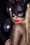 Sexy woman with large breasts, wearing a black mask Easter bunny Royalty Free Stock Photo