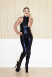 Sexy woman in latex catsuit posing Royalty Free Stock Image