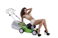 Sexy woman with lawn mower Stock Photos