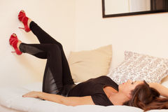 Sexy woman laying on the bed Stock Image