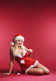 A sexy woman laying in erotic Christmas lingerie Stock Images