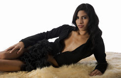 woman laying on fur rug Stock Photography