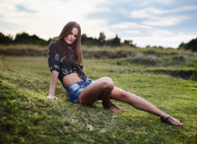 Sexy woman laying on the grass Royalty Free Stock Photos