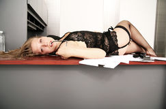 Sexy Woman Laying On Table Royalty Free Stock Photo