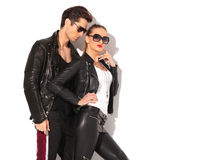 Sexy woman in leather clothes standing near boyfriend Stock Photo