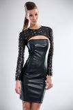 Sexy woman in leather dress Stock Image