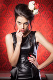 Sexy woman in leather jacket bitting her lips Royalty Free Stock Images
