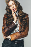 Sexy woman in leather jacket and golden crown Stock Photo