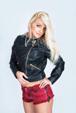 woman in leather jacket and red shorts Stock Image