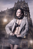 Sexy woman in leather jacket and skirt Royalty Free Stock Images