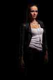 Sexy woman in leather jacket and undershirt standing Stock Photo