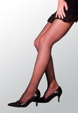 Sexy woman leg. Dressed in stockings and high heels of women's sexy legs Royalty Free Stock Photos