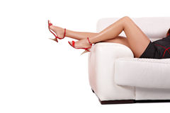 Sexy woman legs. With heels over sofa isolated on white Stock Images