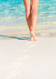 Sexy woman legs. Closeup photo of sexy woman legs, body part, slim female walking on the beach, carefree lifestyle, summer vacation, relaxation concept Stock Photos