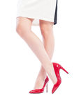 Sexy woman legs crossed wearing high heel red shoes Royalty Free Stock Image