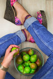 Sexy woman legs on the floor with plate of pears. Top view Royalty Free Stock Photo