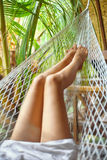 Sexy woman legs in hammock.Vacation concept Stock Image