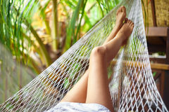 Sexy woman legs in hammock.Vacation concept Stock Images
