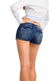 Sexy woman legs in jean shorts, isolated on white background Stock Image