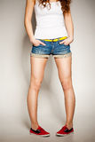 Sexy woman legs in jean shorts Stock Photo