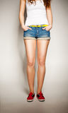 Sexy woman legs in jean shorts Stock Image