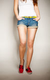 Sexy woman legs in jean shorts Royalty Free Stock Photos
