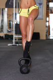 Sexy woman legs with kettlebell Stock Photography