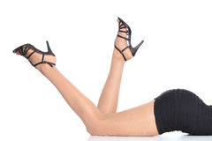 Sexy woman legs with stockings and heels pointing up Stock Image