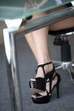 Sexy woman legs under desk Stock Photos