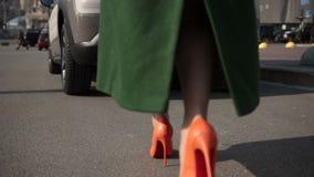 Sexy woman legs walking on cobblestone street stock footage