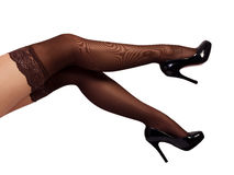 Sexy woman legs wearing pantyhose and black high heels Royalty Free Stock Image