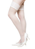 Sexy woman legs in white stockings Stock Image