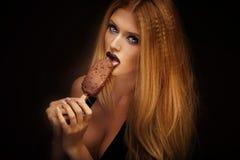 Sexy woman licking chocolate ice cream. Stock Photos