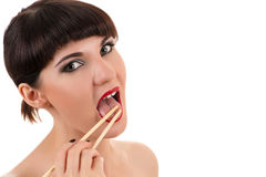Sexy woman licking chopsticks Royalty Free Stock Image